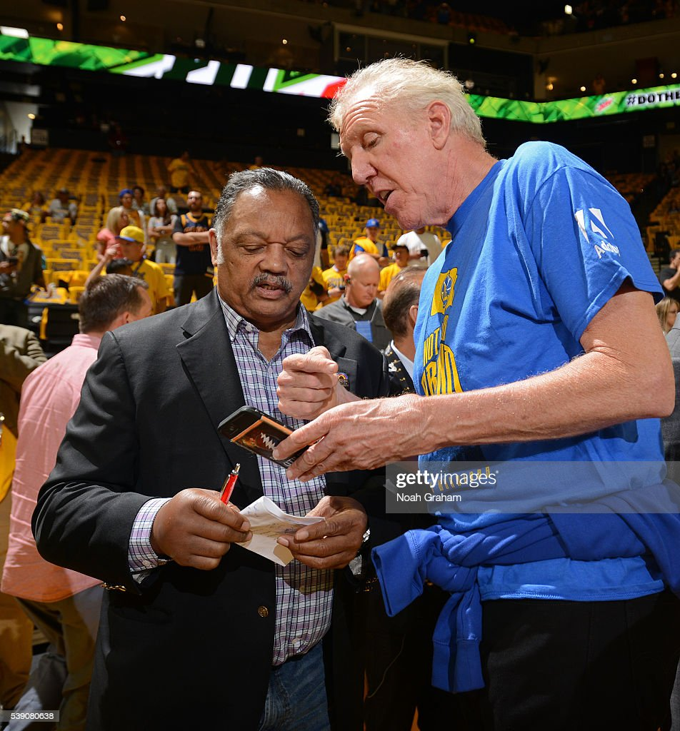 Jessie Jackson speaks with Bill Walton before the Golden State Warriors face the Cleveland Cavaliers for Game Two of the 2016 NBA Finals on June 5, 2016 at ORACLE Arena in Oakland, California.