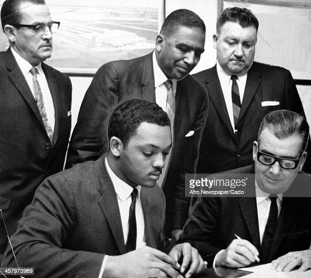 Jesse Jackson Sr, John Finley and members of Dr Martin Luther King Jr's Operation Breadbasket sign an agreement with the National Tea Company to...