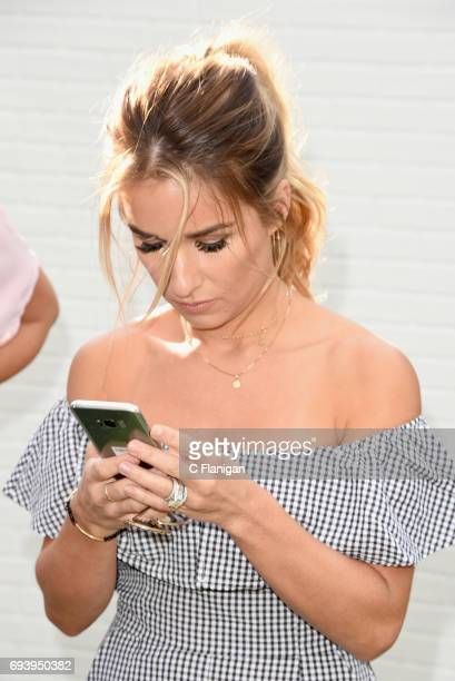 Jesse James Decker tries out the new Samsung Galaxy S8 during the Samsung Women in Country x Change The Conversation Dinner on June 8 2017 at...