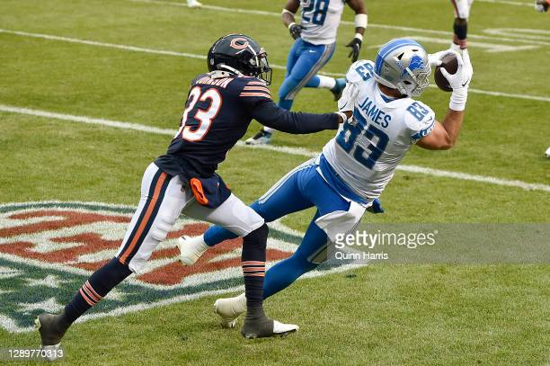 Jesse James of the Detroit Lions catches a nine-yard touchdown reception against Jaylon Johnson of the Chicago Bears during the second half at...