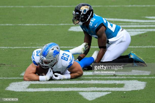 Jesse James of the Detroit Lions lays on the ground after being tackled by Jarrod Wilson of the Jacksonville Jaguars during the first quarter in the...