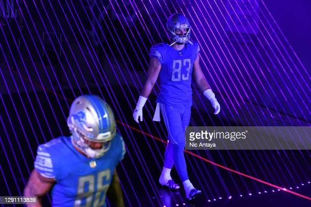 Jesse James of the Detroit Lions walks to the field before the game against the Green Bay Packers at Ford Field on December 13, 2020 in Detroit,...