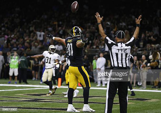 Jesse James of the Pittsburgh Steelers celebrates a touchdown on a 5-yard reception during the first half of a game against the New Orleans Saints at...