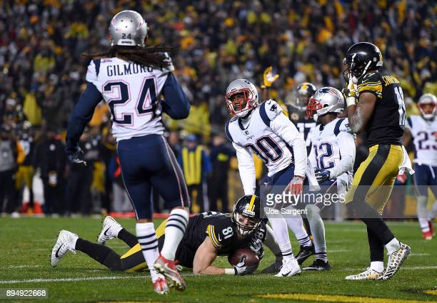Jesse James of the Pittsburgh Steelers dives for the end zone for an apparent touchdown in the fourth quarter during the game against the New England...
