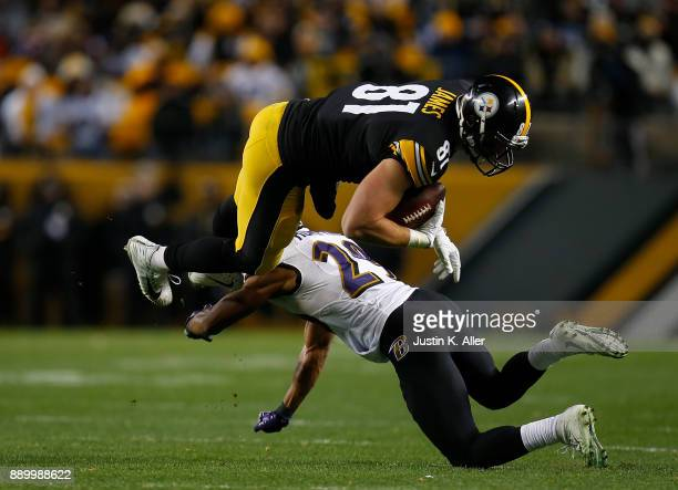 Jesse James of the Pittsburgh Steelers goes airborne after being hit by Marlon Humphrey of the Baltimore Ravens in the second half during the game at...