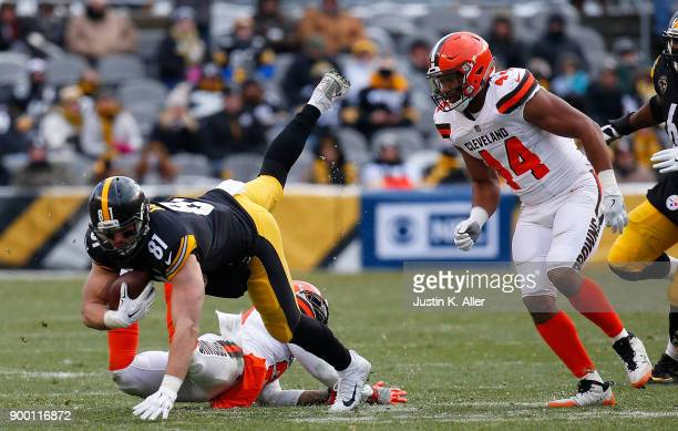 Jesse James of the Pittsburgh Steelers is knocked in the air by Jamar Taylor of the Cleveland Browns in the second half during the game at Heinz...