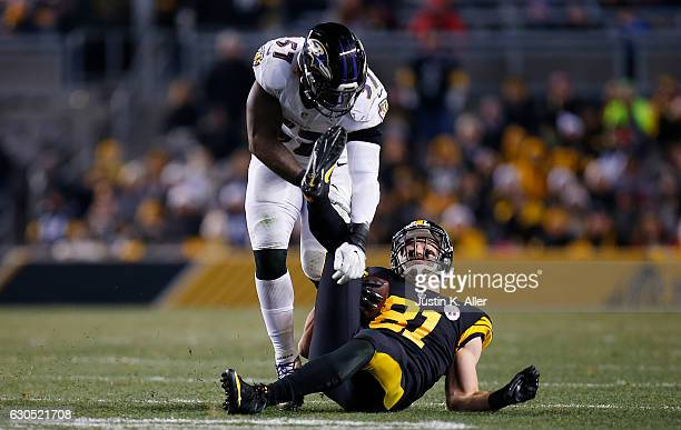 Jesse James of the Pittsburgh Steelers is knocked to the ground by C.J. Mosley of the Baltimore Ravens in the second half during the game at Heinz...