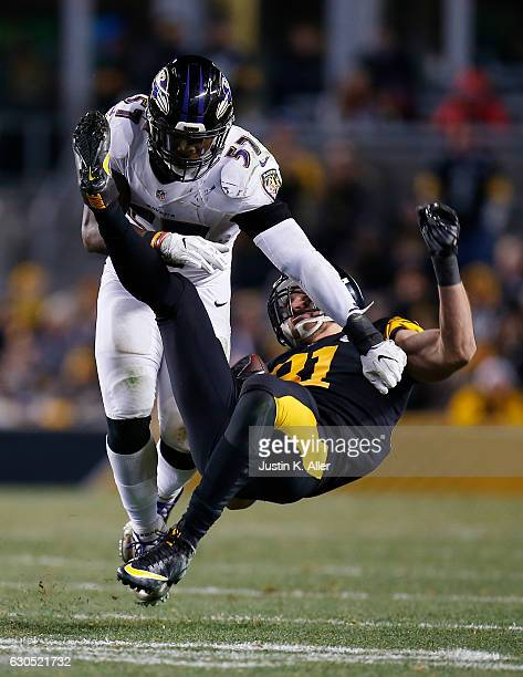 Jesse James of the Pittsburgh Steelers is knocked to the ground by /C.J. Mosley of the Baltimore Ravens in the second half during the game at Heinz...