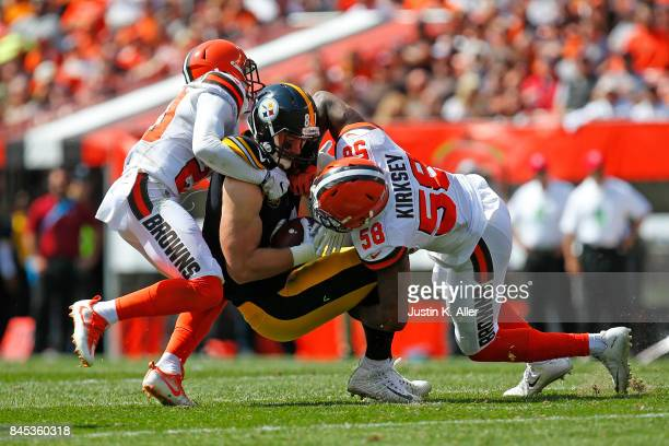 Jesse James of the Pittsburgh Steelers is tackled by Christian Kirksey of the Cleveland Browns at FirstEnergy Stadium on September 10 2017 in...