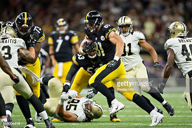 Jesse James of the Pittsburgh Steelers runs the ball after catching a pass during a preseason game against the New Orleans Saints at Mercedes-Benz...
