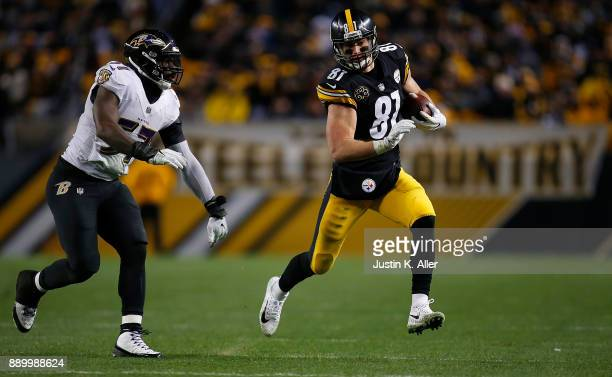 Jesse James of the Pittsburgh Steelers runs up field after a catch in the second half during the game against the Baltimore Ravens at Heinz Field on...