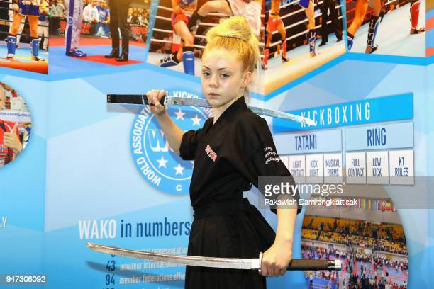 Jesse Jane McParland poses for photographs at the WAKO booth during day three of the SportAccord at Centara Grand Bangkok Convention Centre on April...