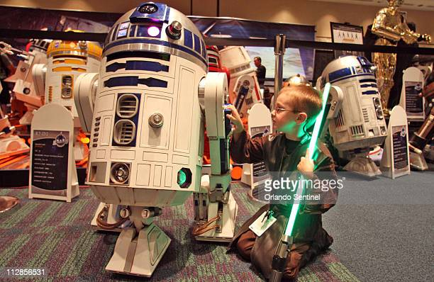"""Jesse """"Jedi"""" Powers of Tilton, New Hampshire fiddles with an R2D2 robot Thursday, August 12, 2010 that his dad built while they attend the Star Wars..."""