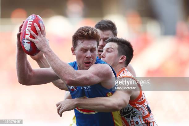 Jesse Joyce of the Suns is tackled by Toby Greene of the Giants during the round 11 AFL match between the Greater Western Sydney Giants and the Gold...