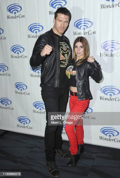 Jesse Kove and Ainsley Ross attend Season 2 of YouTube Red's 'Kobra Kai panel at WonderCon 2019 Day 2 held at Anaheim Convention Center on March 30...