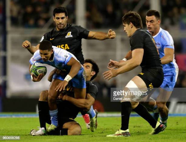 Jesse Kriel of Bulls is tackled by Sebastian Cancelliere of Jaguares during a match between Jaguares and Bulls as part of Super Rugby 2018 at Estadio...