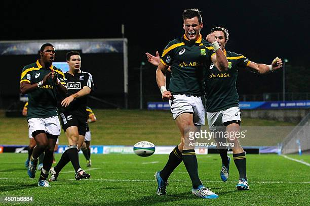 Jesse Kriel of South Africa celebrates after scoring a try during the 2014 Junior World Championships match between New Zealand and South Africa at...