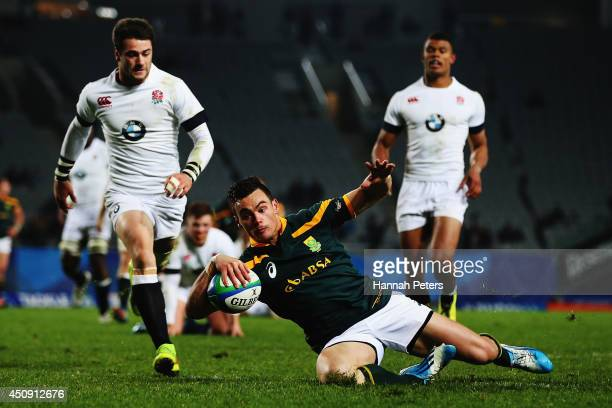 Jesse Kriel of South Africa dives over to score a try during the 2014 Junior World Championship Final match between South Africa and England at Eden...
