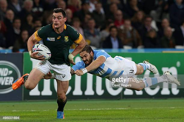 Jesse Kriel of South Africa evades a challenge from Horacio Agulla of Argentina during the 2015 Rugby World Cup Bronze Final match between South...