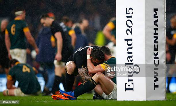 Jesse Kriel of South Africa is consoled by Sonny Bill Williams of the New Zealand All Blacks at the end of the match during the 2015 Rugby World Cup...