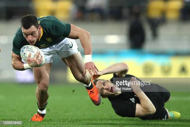 Jesse Kriel of South Africa is tackled by Ben Smith of the All Blacks during The Rugby Championship match between the New Zealand All Blacks and the...