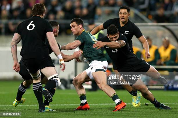 Jesse Kriel of South Africa is tackled by Codie Taylor of New Zealand during The Rugby Championship match between the New Zealand All Blacks and the...