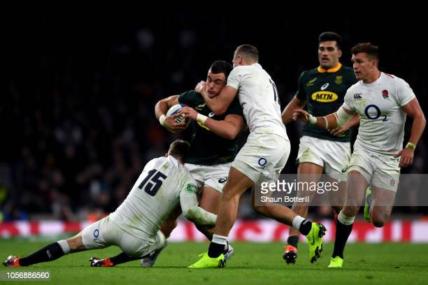 Jesse Kriel of South Africa is tackled by Elliot Daly and Jonny May of England during the Quilter International match between England and South...