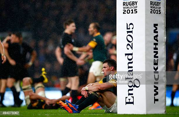 Jesse Kriel of South Africa sits dejected by the post pads at the end of the match during the 2015 Rugby World Cup Semi Final match between South...