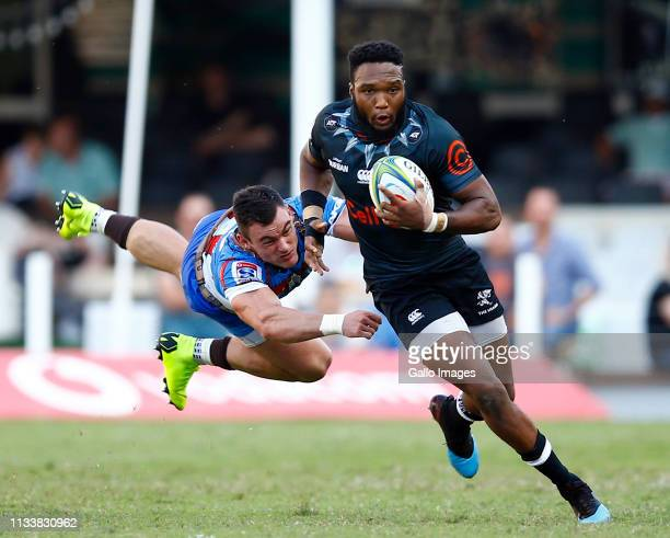 Jesse Kriel of the Vodacom Bulls looks to tackle Lukhanyo Am of the Cell C Sharks during the Super Rugby match between Cell C Sharks and Vodacom...