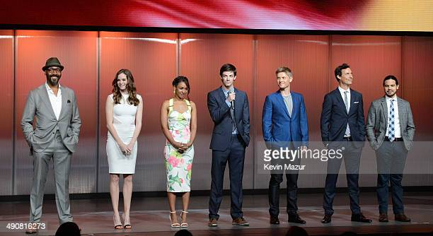 Jesse L Martin Danielle Panabaker Candice Patton Grant Gustin Rick Cosnett Tom Cavanagh and Carlos Valdes speak onstage at The CW Network's 2014...
