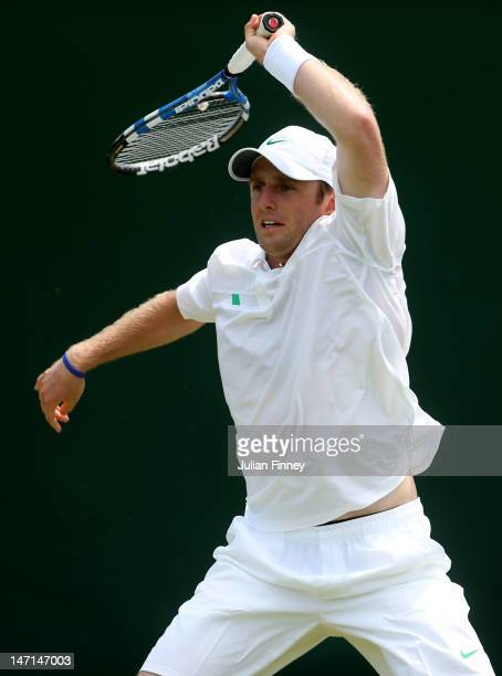 Jesse Levine of the USA hits a backhand return during his Gentlemen's Singles first round match against Karol Beck Slovak Republic on day two of the...
