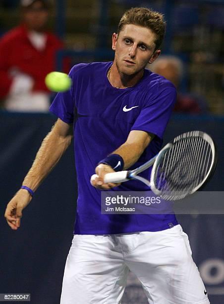 Jesse Levine returns to Juan Martin Del Potro of Argentina during the Legg Mason Tennis Classic at the William H.G. FitzGerald Tennis Center on...