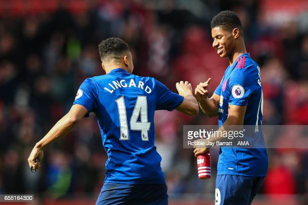 Jesse Lingaard of Manchester United and Marcus Rashford of Manchester United celebrate at full time during the Premier League match between...