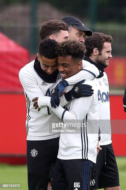 Jesse Lingard and Angel Gomes of Manchester United in action during a first team training session at Aon Training Complex on May 19 2017 in...