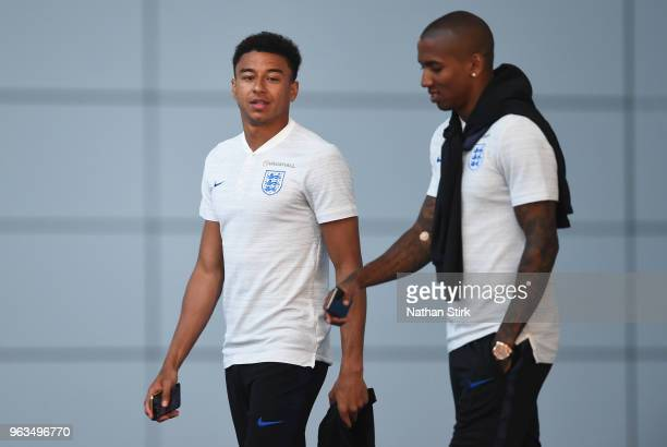 Jesse Lingard and Ashley Young walk during a media event after an England training session at St Georges Park on May 28 2018 in BurtonuponTrent...