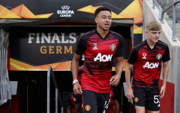 Jesse Lingard and Brandon Williams of Manchester United walk out to warm up prior to the UEFA Europa League Quarter Final between Manchester United...