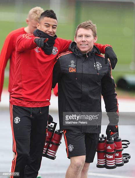 Jesse Lingard and Fitness Coach Gary Walker of Manchester United in action during a first team training session at Aon Training Complex on November...
