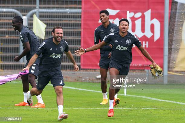 Jesse Lingard and Juan Mata of Manchester United react during a training session at RheinEnergieStadion on August 15 2020 in Cologne Germany