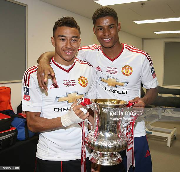 Jesse Lingard and Marcus Rashford of Manchester United celebrate in the dressing room with the FA Cup trophy after The Emirates FA Cup final match...