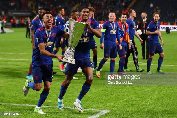 Jesse Lingard and Marcus Rashford of Manchester United celebrate with the trophy following the UEFA Europa League Final match between Ajax and...