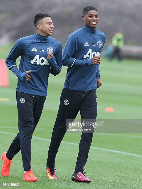 Jesse Lingard and Marcus Rashford of Manchester United in action during a first team training session at Aon Training Complex on July 28 2016 in...