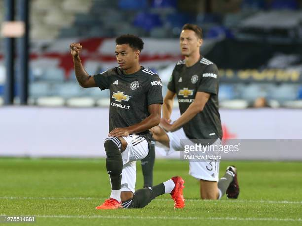 Jesse Lingard and Nemanja Matic of Manchester United take a knee in support of the Black Lives Matter campaign ahead of the Carabao Cup Third Round...