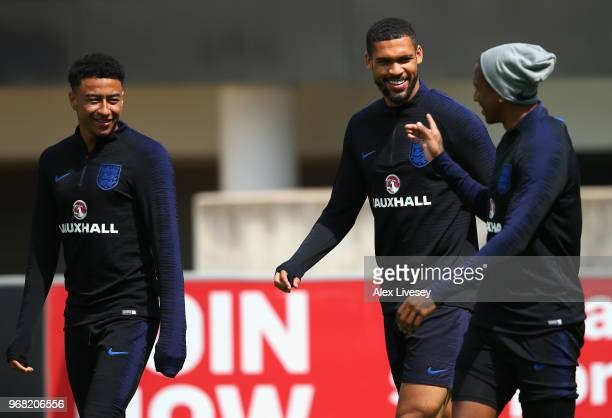 Jesse Lingard and Ruben LoftusCheek share a joke with Ashley Young of England during the England training session at St Georges Park on June 6 2018...