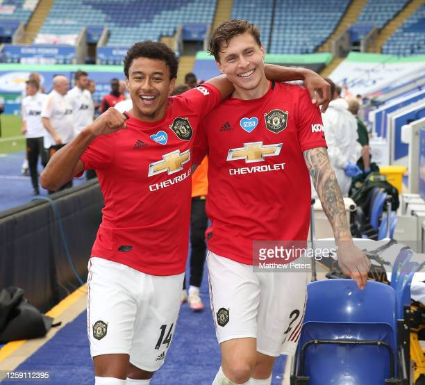 Jesse Lingard and Victor Lindelof of Manchester United celebrate after the Premier League match between Leicester City and Manchester United at The...