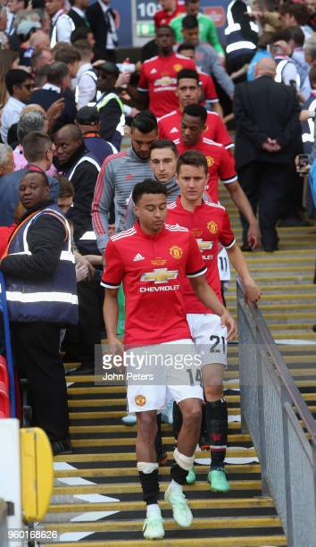 Jesse Lingard Ander Herrera and Matteo Darmian of Manchester United show their disappointment after the Emirates FA Cup Final match between...