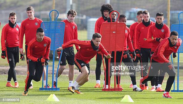 Jesse Lingard Ander Herrera and Memphis Depay of Manchester United in action during a first team training session ahead of their UEFA Europa League...