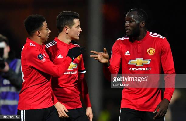 Jesse Lingard Ander Herrera and Romelu Lukaku of Manchester United react after The Emirates FA Cup Fourth Round match between Yeovil Town and...