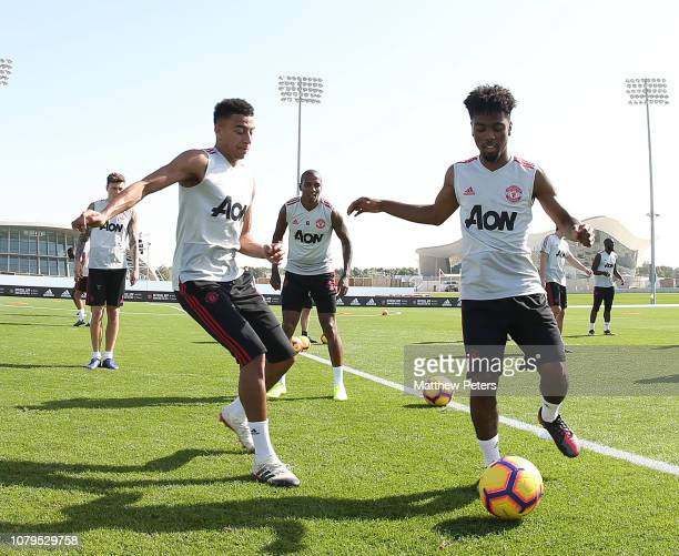 Jesse Lingard Ashley Young and Angel Gomes of Manchester United in action during a first team training session at Nad Al Sheba Sports Complex on...