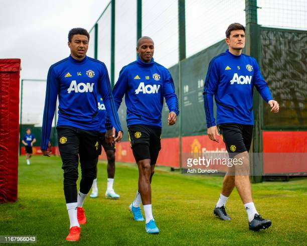 Jesse Lingard Ashley Young and Harry Maguire of Manchester United in action during a first team training session at Aon Training Complex on August 14...