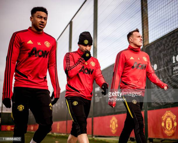 Jesse Lingard Luke Shaw and Phil Jones of Manchester United in action during a first team training session at Aon Training Complex on November 20...